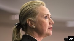 Secretary of State Hillary Rodham Clinton says the United States must continue sending diplomats and aid workers to the Arab world's emerging democracies, despite last month's deadly attack in Libya, Oct. 12, 2012.