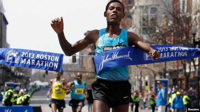 Lelisa Desisa Benti of Ethiopia crosses the finish line to win the men's division of the 117th Boston Marathon in Boston, Massachusetts April 15, 2013.