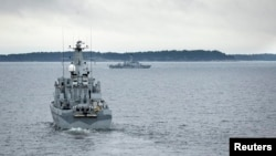 Swedish minesweeper HMS Kullen patrols the Stockholm Archipelago, Oct. 19, 2014, searching for what the military says could be a foreign underwater threat.