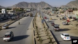 Vehicles cross on newly-constructed Darul Aman street in Kabul, Afghanistan, April 21, 2011.