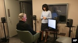 FILE - A research audiologist conducts a hearing test on a patient at the Phonak US Audiology Research Center in Warrenville, Ill., Dec. 18, 2014.