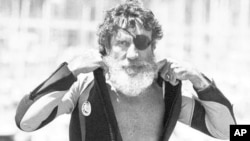 FILE - Jack O'Neill suits up in the small craft harbor before windsurfing off Santa Cruz, Calif., Aug. 5, 1982. A California surfing world icon who pioneered the wetsuit, O'Neill died June 2, 2017, at age 94.