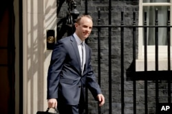 Britain's new Secretary of State for Exiting the European Union Dominic Raab leaves 10 Downing Street after it was announced he was appointed to the job in London, July 9, 2018.