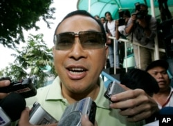 FILE - In this Jan. 11, 2008 file photo, Hutomo Mandala Putra, popularly known as Tommy, the youngest son of former Indonesian President Suharto is mobbed by journalists in Jakarta, Indonesia.