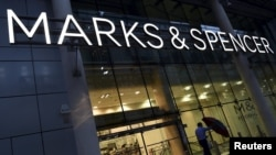 FILE - A man leaves a Marks & Spencer store in London, Britain. Orient Craft, an Indian company exporting to retailers such as Marks and Spencer in Britain, says it is deeply worried about the upcoming June 23 referendum.
