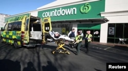 A patient is wheeled to an ambulance after a stabbing incident at the Countdown supermarket, in Dunedin, New Zealand, May 10, 2021 in this screen grab taken from a video. Otago Daily Times/ via REUTERS