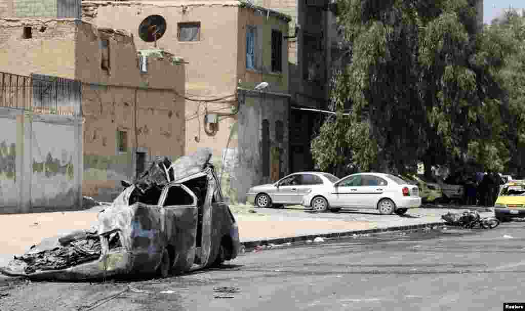 A burnt car in the al-Midan neighborhood in Damascus, July 20, 2012.