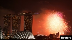 Fireworks explode in Marina Bay during New Year celebrations in Singapore, Jan. 1, 2017.