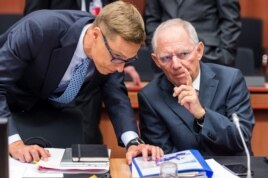 German Finance Minister Wolfgang Schaeuble, right, talks with Finnish Finance Minister Alexander Stubb during a meeting of eurogroup finance ministers at the EU Council building in Brussels, Belgium, July 13, 2015.