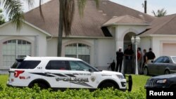 Police stand in front of one of the houses that officials indicated was connected to the Orlando shooter in Port St. Lucie, Florida, U.S. June 12, 2016.