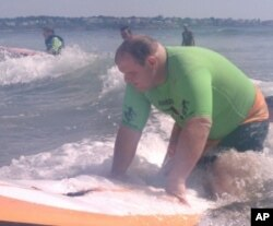 Matthew Fish - whose vision is so poor, he needs a cane to get around - learns to surf.