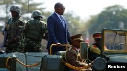 FILE - Burundi's President Pierre Nkurunziza arrives for the celebrations to mark Burundi's 55th anniversary of independence at the Prince Louis Rwagasore stadium in Bujumbura, Burundi, July 1, 2017.