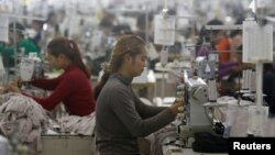 Employees work at a factory supplier of the H&M brand in Kandal province, Cambodia, December 12, 2018.