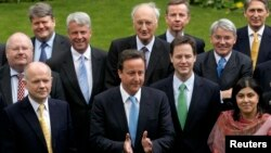 FILE - Britain's Prime Minister David Cameron (front C) is pictured with some members of his cabinet in a May 2010 group picture in the garden of 10 Downing Street in London.
