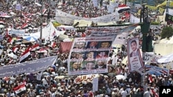 Egyptians crowd at Tahrir Square in Cairo, the focal point of the uprising, to demand justice for victims of Hosni Mubarak's regime and press the new, military rulers for a clear plan of transition to democracy, July 8, 2011