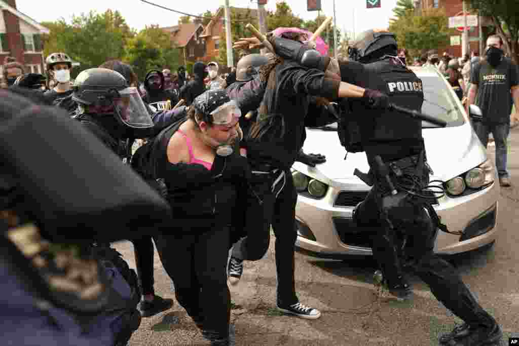Police and protesters clash on September 23, 2020 in Louisville, Kentucky after a grand jury charged one officer on criminal charges six months after Breonna Taylor was shot and killed by police in Kentucky.