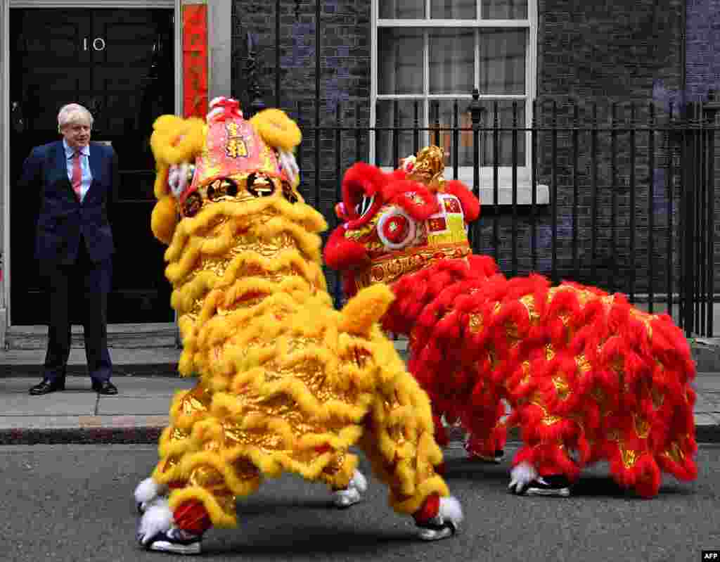 Britain's Prime Minister Boris Johnson reacts as he watches Chinese Lions perform, as he hosts a Chinese New Year reception at 10 Downing Street in central London.