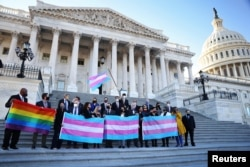 Democratic members of the U.S. House of Representatives pose for a photograph holding LBGT+ and Transgender Pride flags on the steps of the U.S. Capitol ahead of a vote on the Equality Act on Capitol Hill in Washington, U.S., February 25, 2021.