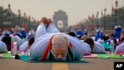 Indian Prime Minister Narendra Modi performs yoga with a crowd of thousands in New Delhi, India, June 21. (AP Photo/Saurabh Das)