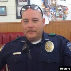Brent Thompson, of Dallas Area Rapid Transit, one of five officers killed in a shooting incident in Dallas, Texas, U.S., is pictured in this undated handout photo obtained by Reuters July 8, 2016.