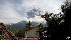 Volcanic material from the eruption of Mount Barujari is seen from Bayan, Lombok Island, Indonesia, Sept. 27, 2016.
