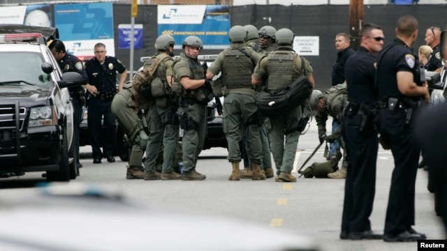 Police officers gather during a search at Santa Monica College.
