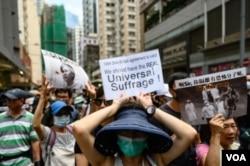 """Protesta """"Oración por los Pecadores"""" en Hong Kong, el sábado 31 de agosto de 2019. Miles de manifestantes prodemocracia desafiaron una prohibición de la policía a la protesta, un día después que varios líderes activistas fueron arrestados."""
