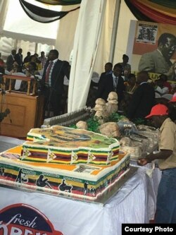 A birthday cake for President Robert Mugabe ...