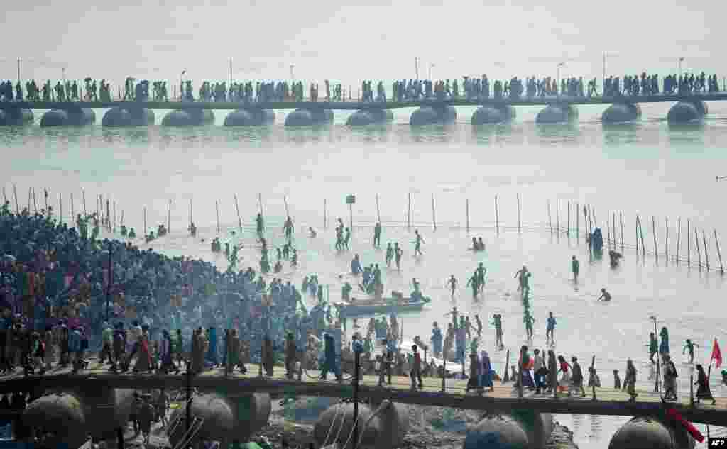 Indian Hindu devotees gather on the banks of the river Ganges to take a 'holy dip' on the occasion of Maghi Purnima during the annual traditional fair 'Magh Mela' in Allahabad.