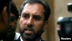 FILE - Samiullah Afridi, lawyer for Shakil Afridi who ran a fake vaccination campaign to try help U.S. officials find al-Qaida chief Osama bin laden, speaks after appearing before the court in Peshawar, Pakistan.