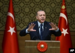 Turkey's President Recep Tayyip Erdogan addresses local administrators in Ankara, Turkey, Feb. 8, 2018. Turkish officials say the leaders of Turkey, Russia and Iran will meet in Istanbul to discuss peace efforts for Syria.