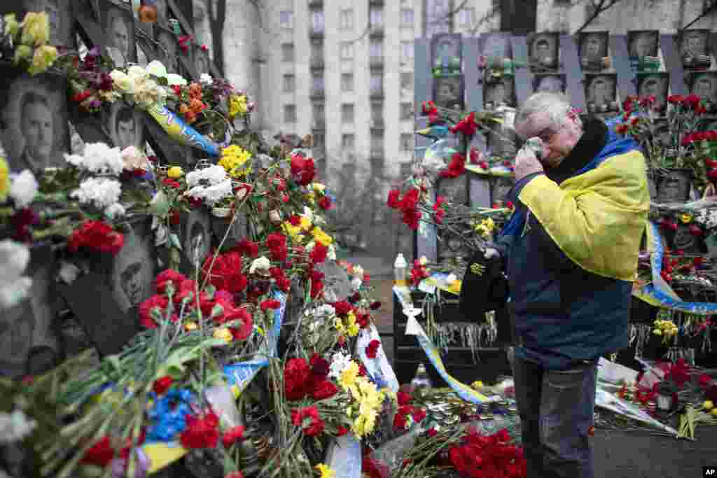 A man cries as he pays his respects at a memorial at the Independent Square (Maidan) in Kyiv, Ukraine, dedicated to people who died in clashes with security forces five years ago.