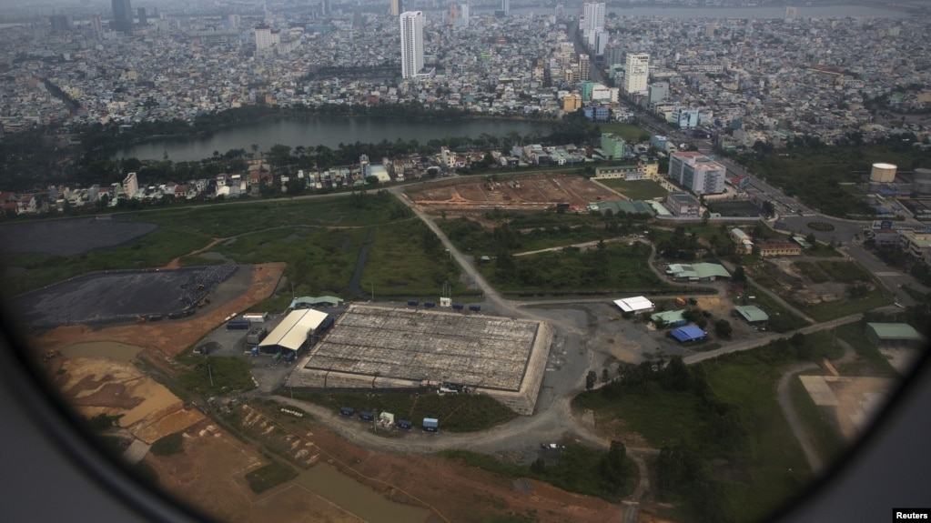 FILE - The cleaning operation of the area that was used for storing Agent Orange is seen from a plane taking off from Danang international airport.