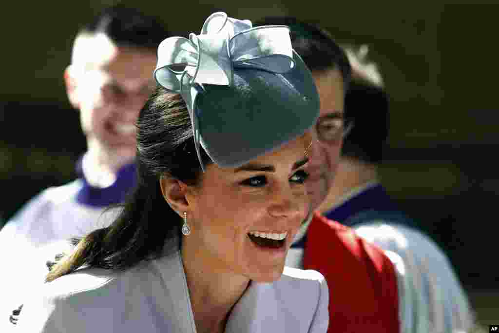 Britain's Kate, the Duchess of Cambridge, meets members of the cathedral choir following an Easter Sunday service at St. Andrews Cathedral in Sydney, Sunday, April 20, 2014. Kate and her husband Prince William, along with their son Prince George, are on a