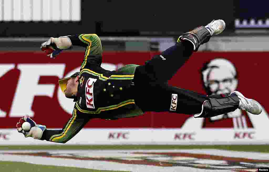 Australia's Matthew Wade dives to stop the ball during the Twenty20 international cricket match against Sri Lanka at the Melbourne Cricket Ground, Australia.
