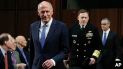 From left, National Intelligence Director Dan Coats, National Security Agency director Adm. Michael Rogers and acting FBI Director Andrew McCabe, arrive for the Senate Intelligence Committee hearing about the Foreign Intelligence Surveillance Act, on Capitol Hill, June 7, 2017, in Washington.