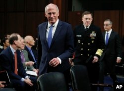 From left, National Intelligence Director Dan Coats, National Security Agency director Adm. Michael Rogers and acting FBI Director Andrew McCabe, arrive for the Senate Intelligence Committee hearing about the Foreign Intelligence Surveillance Act, on Capitol Hill.