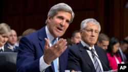 U.S. Secretary of State John Kerry, left, and U.S. Defense Secretary Chuck Hagel, right, appear before the Senate Foreign Relations Committee, Sept. 3, 2013, on Capitol Hill in Washington.