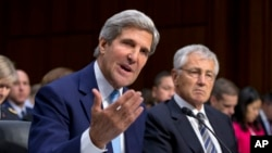 Secretary of State John Kerry, left, and Defense Secretary Chuck Hagel, right, appear before the Senate Foreign Relations Committee, Sept. 3, 2013, on Capitol Hill in Washington.