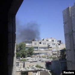 Smoke rises from the suburb of Erbeen in Damascus July 19, 2012.