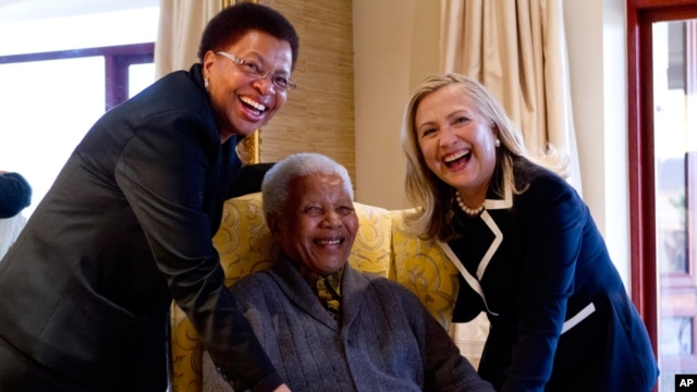 Secretary of State Hillary Rodham Clinton meets with former South Africa President Nelson Mandela and his wife Graca Machel at his home in Qunu, South Africa, Aug. 6, 2012.