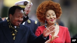 Cameroon's President Paul Biya and First Lady Chantal Biya arrive at the opening ceremony of the Francophone Summit in Montreux, Switzerland, October 23, 2010.