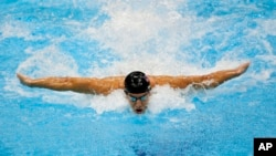 FILE - United States' Michael Phelps swims in the men's 4 X 100-meter medley relay at the Aquatics Center in the Olympic Park during the 2012 Summer Olympics in London.