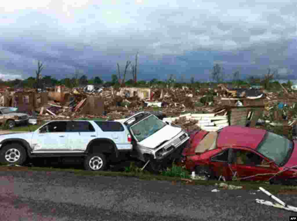 A tornado has flattened Pleasant Grove, Ala., a subdivision of Mountain Grove, Thursday, April 28. 2011. Dozens of tornadoes spawned by a powerful storm system wiped out entire towns across a wide swath of the South, killing at least 194 people, and offic
