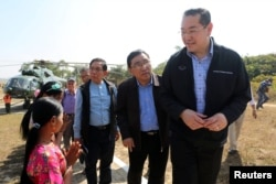 Surakiart Sathirathai, a former Thai foreign minister and chairman of the international advisory board on the crisis in Rakhine state, visits one of the camps set up by Myanmar's Social Welfare, Relief and Resettlement Minister for the repatriation of displaced Rohingyas, outside Maungdaw in the state of Rakhine, Myanmar, Jan. 24, 2018