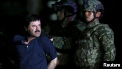 """Joaquin """"El Chapo"""" Guzman is escorted by soldiers during a presentation at the hangar belonging to the office of the Attorney General in Mexico City, Mexico, Jan. 8, 2016."""