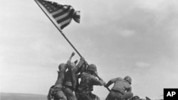 FILE - U.S. Marines raise the American flag atop Mount Suribachi, Iwo Jima, Japan, Feb. 23, 1945. The Marines Corps said Thursday that Private First Class Harold Schultz of Detroit was in the photo and that Navy Pharmacist's Mate 2nd Class John Bradley wasn't.
