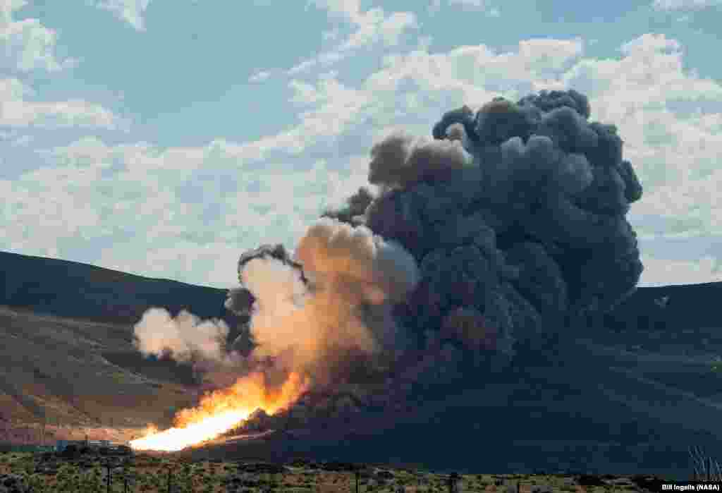 The second and final qualification motor (QM-2) test for the Space Launch System's booster is seen at Orbital ATK Propulsion Systems test facilities in Promontory, Utah. During the Space Launch System flight the boosters will provide more than 75 percent of the thrust needed to escape the gravitational pull of the Earth, the first step on NASA's Journey to Mars.