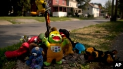 A makeshift memorial of stuffed animals decorates a South Side street corner, Aug. 21, 2017, in Syracuse, N.Y. The memorial was created for 15-year-old Akil Williams, who was shot earlier this summer. From 2014 through this past June, 48 youths aged 12 to 17 in Syracuse were killed or injured in gun violence.