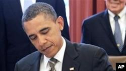 비준안에 서명하는 오바마 대통령